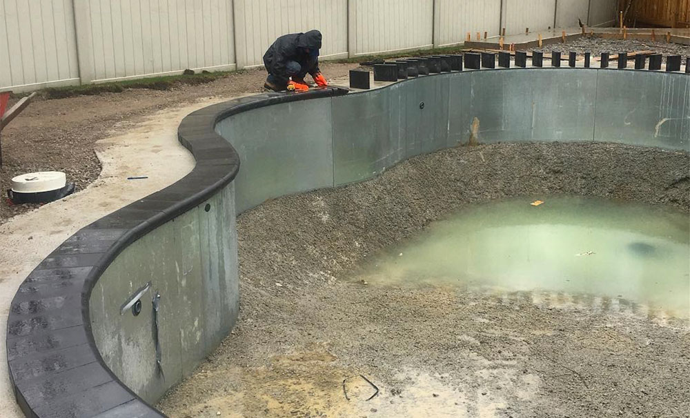 Pool Coping being installed around an in-ground pool